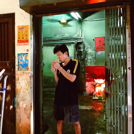 Preed The Street Photographer - 2017 EyeEm Awards BYOPaper! EyeEm Best Shots Bangkok Real People One Person Built Structure Casual Clothing Standing Young Adult Architecture Outdoors Leisure Activity Doorway Lifestyles Mature Adult Building Exterior Day Full Length Young Women Adult People Adults Only