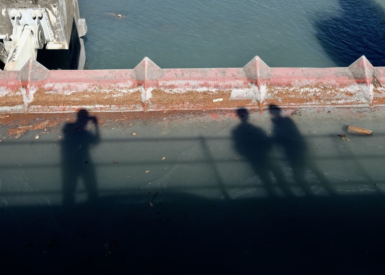 real people, high angle view, water, day, outdoors, shadow, men, lifestyles, nature, built structure, architecture, sky, people