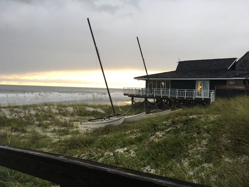 Architecture Built Structure Building Exterior Sunset Grass Sky Cloud - Sky Outdoors Cottage Vacations Canal Town Tourist Resort Tranquility Scenics Coastline Hurricane Stormy Water Storm Cloud Dramatic Sky Seascape Majestic Nature