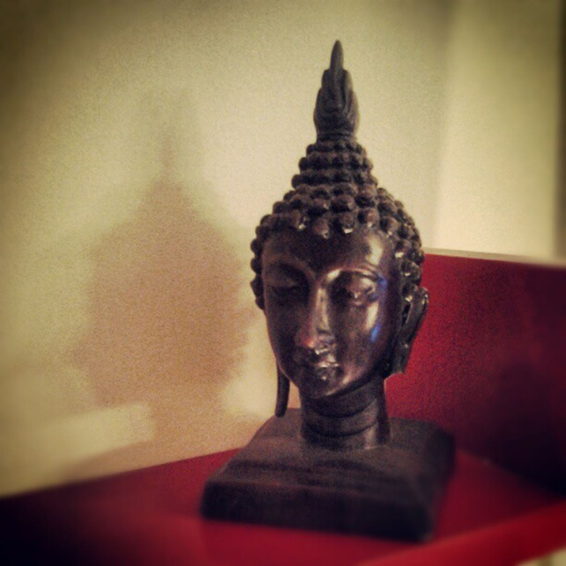 A small hand crafted Buddha we have in our place .. piece of Art