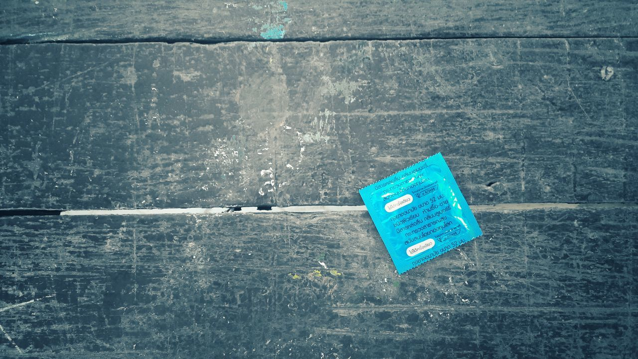 No People Communication Outdoors Day Close-up Condoms : )  Background Condom Blue Happy Protect Wood Colors Background Texture Object