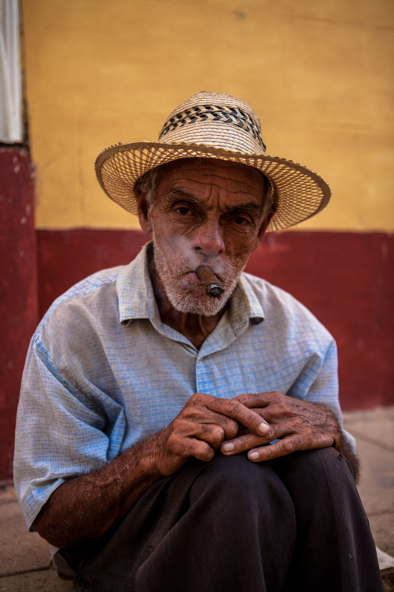 A cuban man poses for tourist' pictures. Casual Clothing Cuba Cuban Leisure Activity Lifestyles Man Mid Adult Men Old Man People Portrait Portrait Photography Sigar Smoke Strawhat Strawhatportraits Trinidad Trinidad, Cuba
