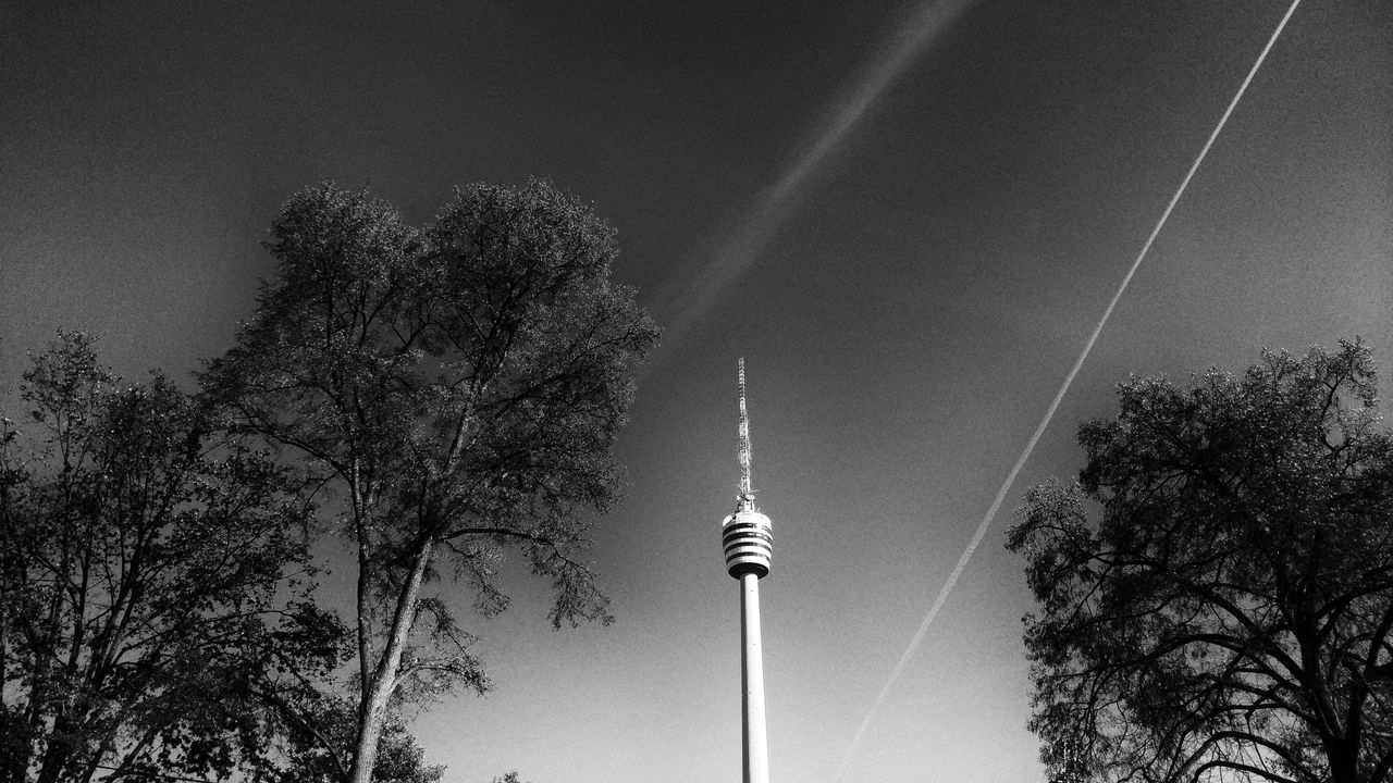 tree, communication, architecture, tall - high, television tower, built structure, low angle view, spire, tower, outdoors, tourism, sky, building exterior, vapor trail, travel, contrail, travel destinations, day, no people, nature, branch, city