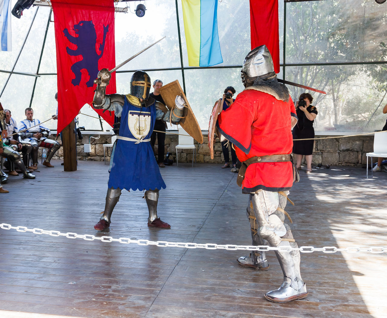 """Jerusalem, Israel, October 03, 2016: Members of the annual festival of """"Knights of Jerusalem"""" dressed as knights, are fighting with swords on the ring in Jerusalem, Israel Ancient Annual Attraction Christian Citizen Decorations Dressed Event Famous Festival History Holy Israel Jerusalem Knight  Land Medieval Member Old Performance Performs Photographer Pose Sword Tradition"""