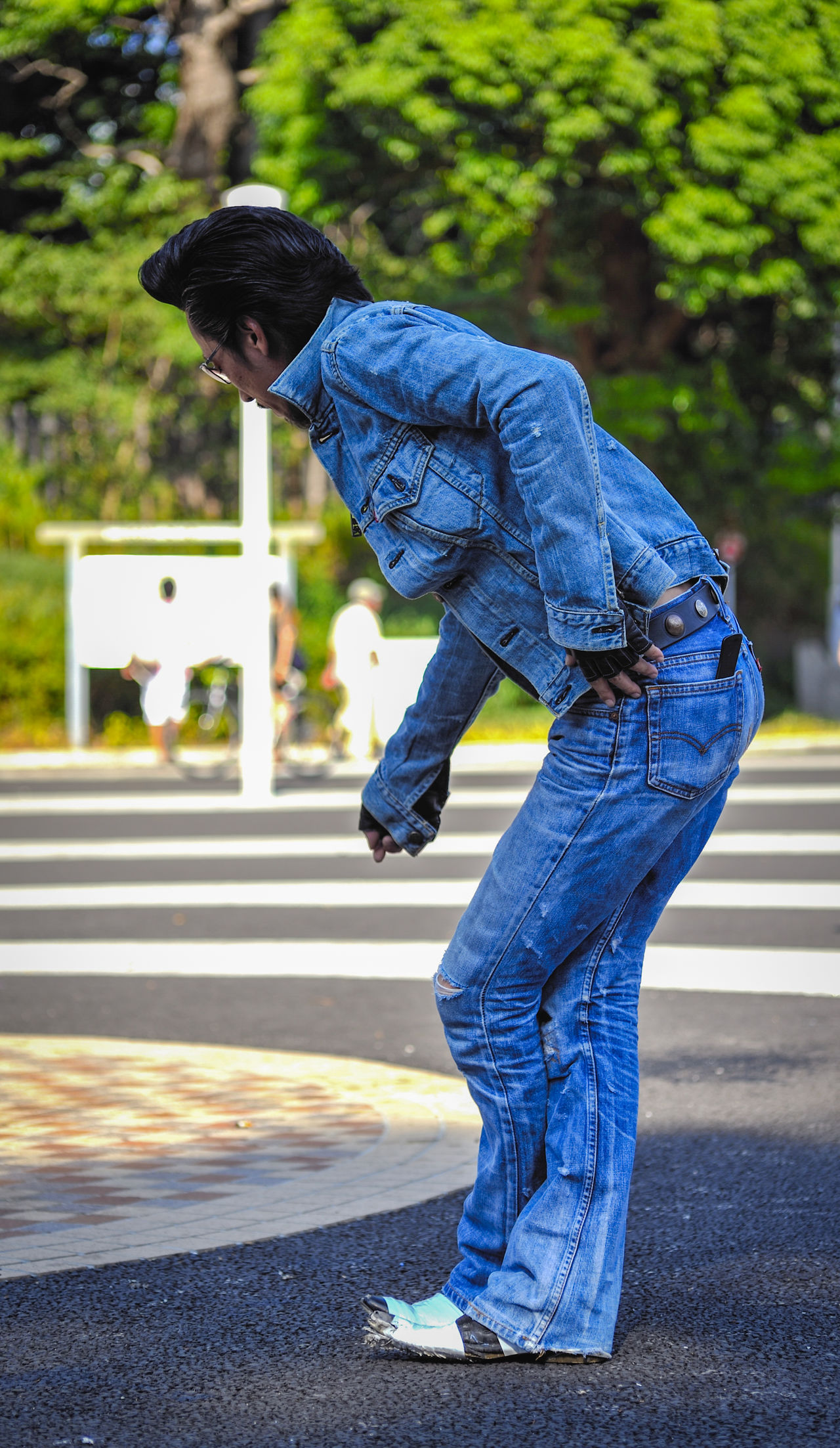 A 50's style rocker in Yoyogi Park, Tokyo. 50's Style Built Structure Casual Clothing Dancer Day Denim Full Length Japan Jeans Leisure Activity Lifestyles One Person Outdoors Real People Road Rock N Roll Side View Young Adult Yoyogi Park The Street Photographer - 2017 EyeEm Awards