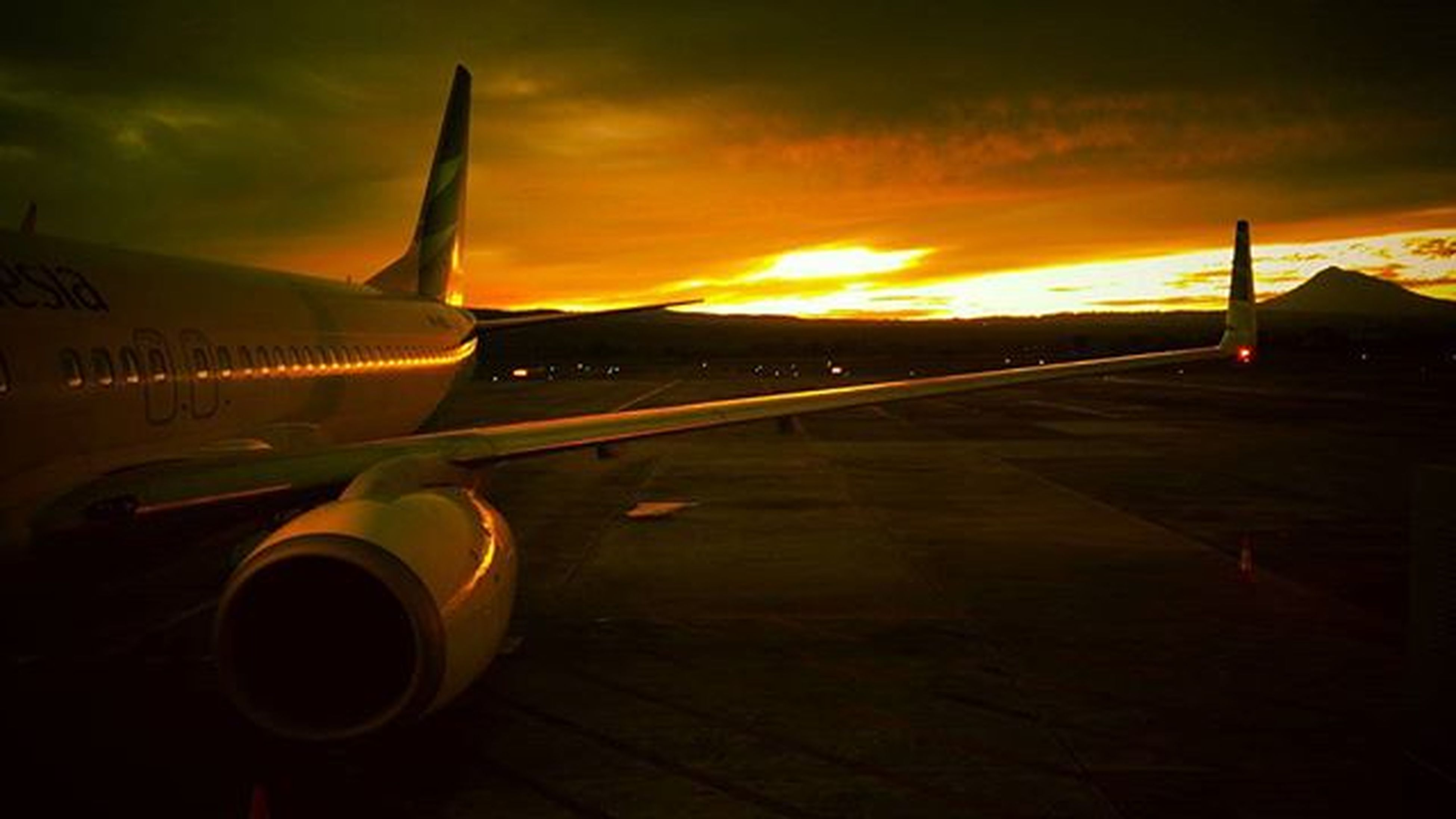 sunset, orange color, transportation, sky, mode of transport, cloud - sky, sunlight, no people, sun, outdoors, airplane, nature, close-up, beauty in nature, yellow, air vehicle, metal, cloud, cropped, scenics