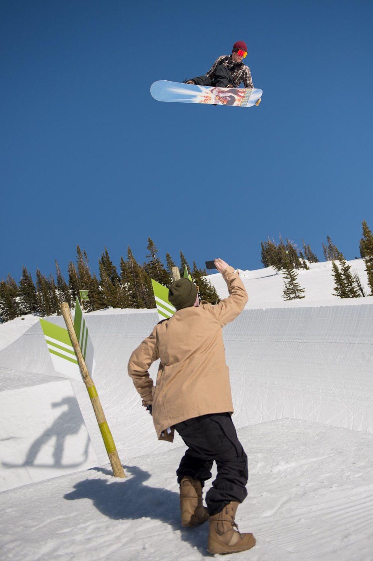 Peacepark Benferguson riding Trevorandrew nabbing the mobile phone image Wyoming Grand Targhee Snowboarding
