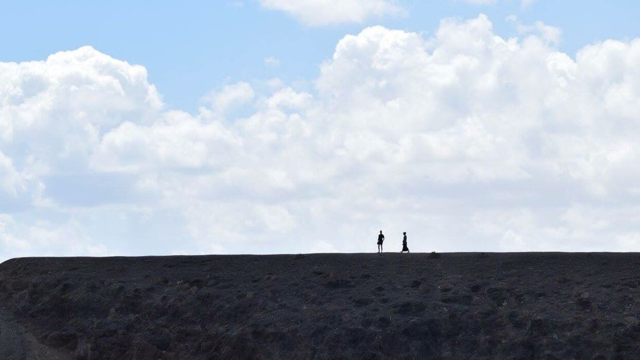 People walking on the cliff top opposite our beach bar in Lanzarote. Sand Sea And Sun People Walking  Cliff Tops Cliffs People In Silhouette The Great Outdoors - 2016 EyeEm Awards Two Is Better Than One