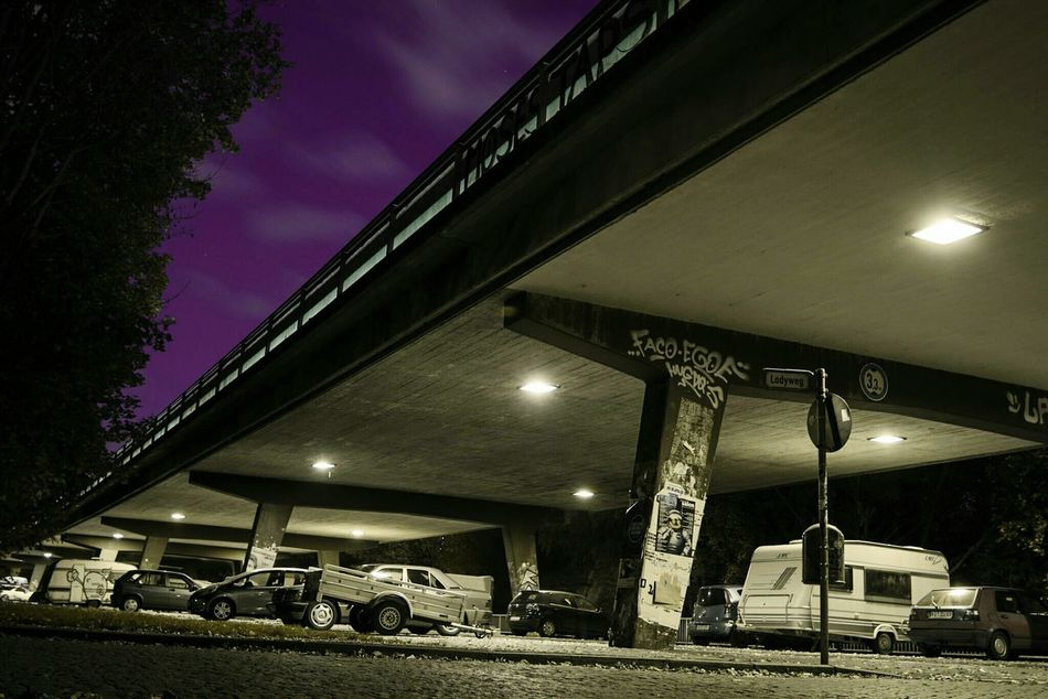 ~ Meanwhile in the Parallel Universe~ Night Illuminated Gas Station Tranquility Sky No People Nature Outdoors Fuel Pump Connection Lines And Shapes Light And Shadow Streetphotography Surreal Street Purple Yellow Color Bridge - Man Made Structure Urban Urban Landscape Architecture City Built Structure Getting Inspired Long Exposure