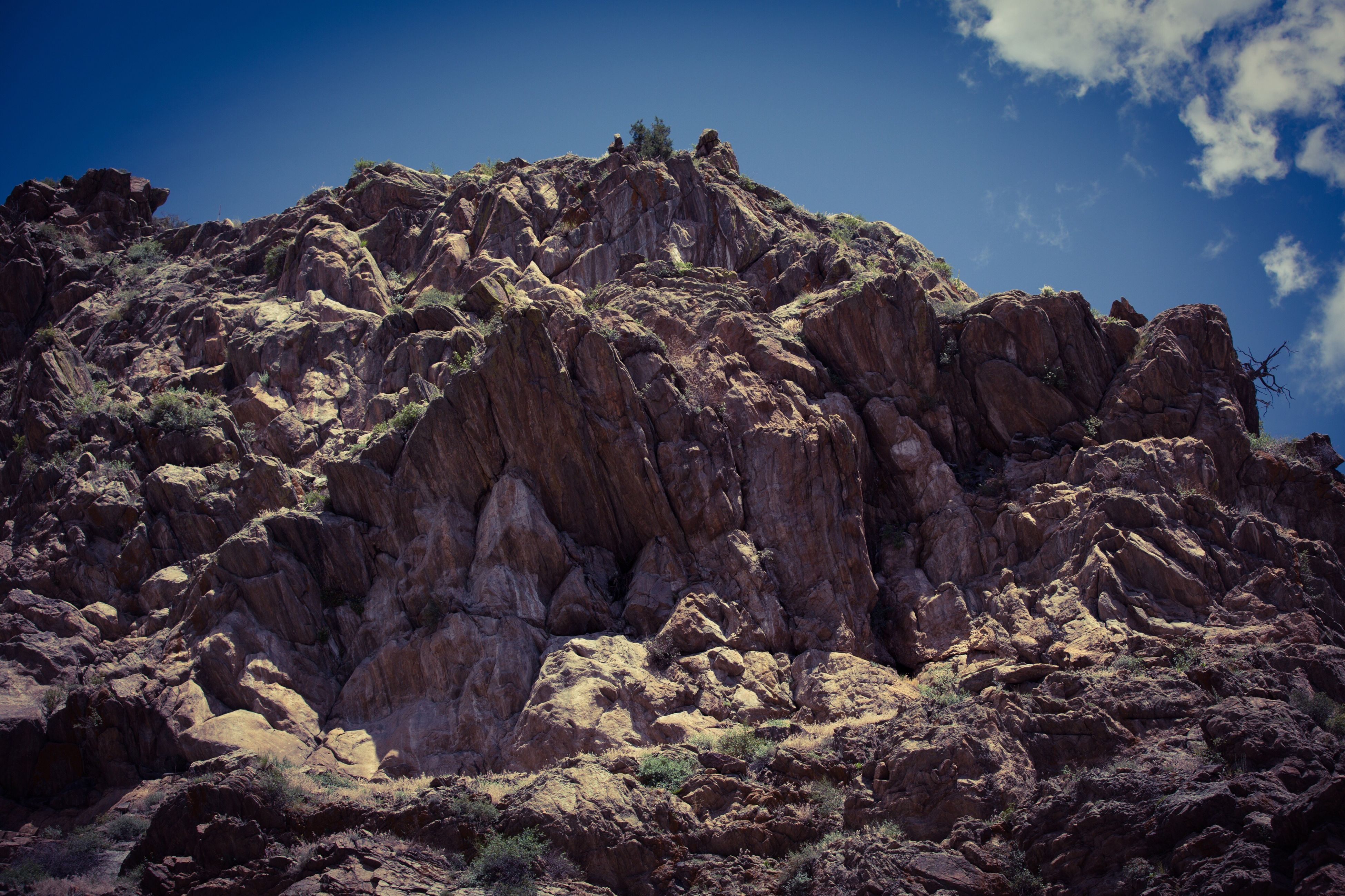 rock formation, mountain, tranquility, rock - object, tranquil scene, scenics, beauty in nature, rocky mountains, nature, low angle view, sky, geology, physical geography, rock, blue, non-urban scene, eroded, landscape, tree, rough
