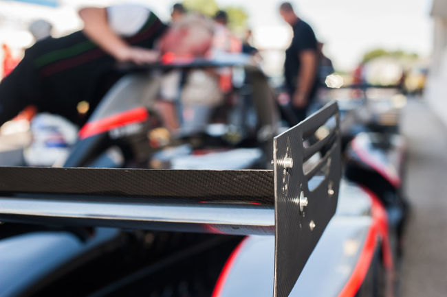 Rear spoiler detail racing car Car Close-up Focus On Foreground Race Racing Rear Spoiler Red Selective Focus Starting Line