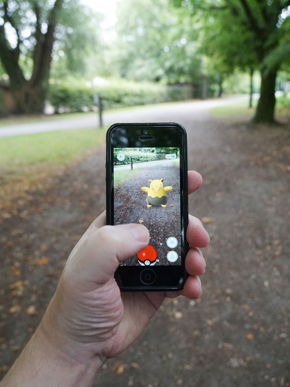 App Augmented Reality Day Editorial  Game Hand Holding IPhone Leisure Activity Lifestyles Mobile Outdoors Person Personal Perspective Play Pocket Monsters Pokemon Go Pokémon POV Smartphone Traumato Unrecognizable Person