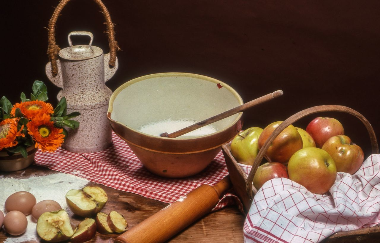 High Angle View Of Apples With Sugar In Bowl On Table