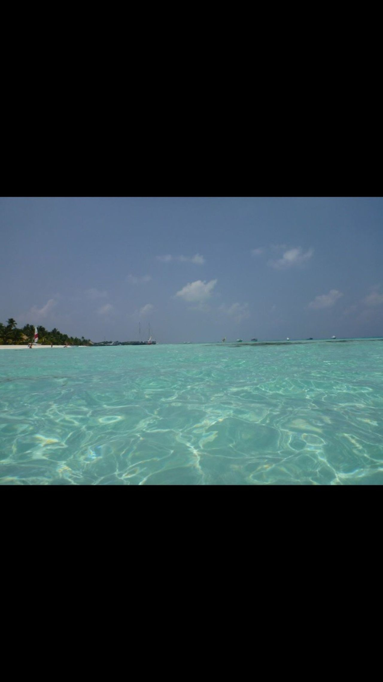 Maldives Turquoise Sea Water Beauty In Nature Horizon Over Water Blue Sky Beach No People Holiday Amazing Wonderful Place Swimming Crystal Clear Waters Fun