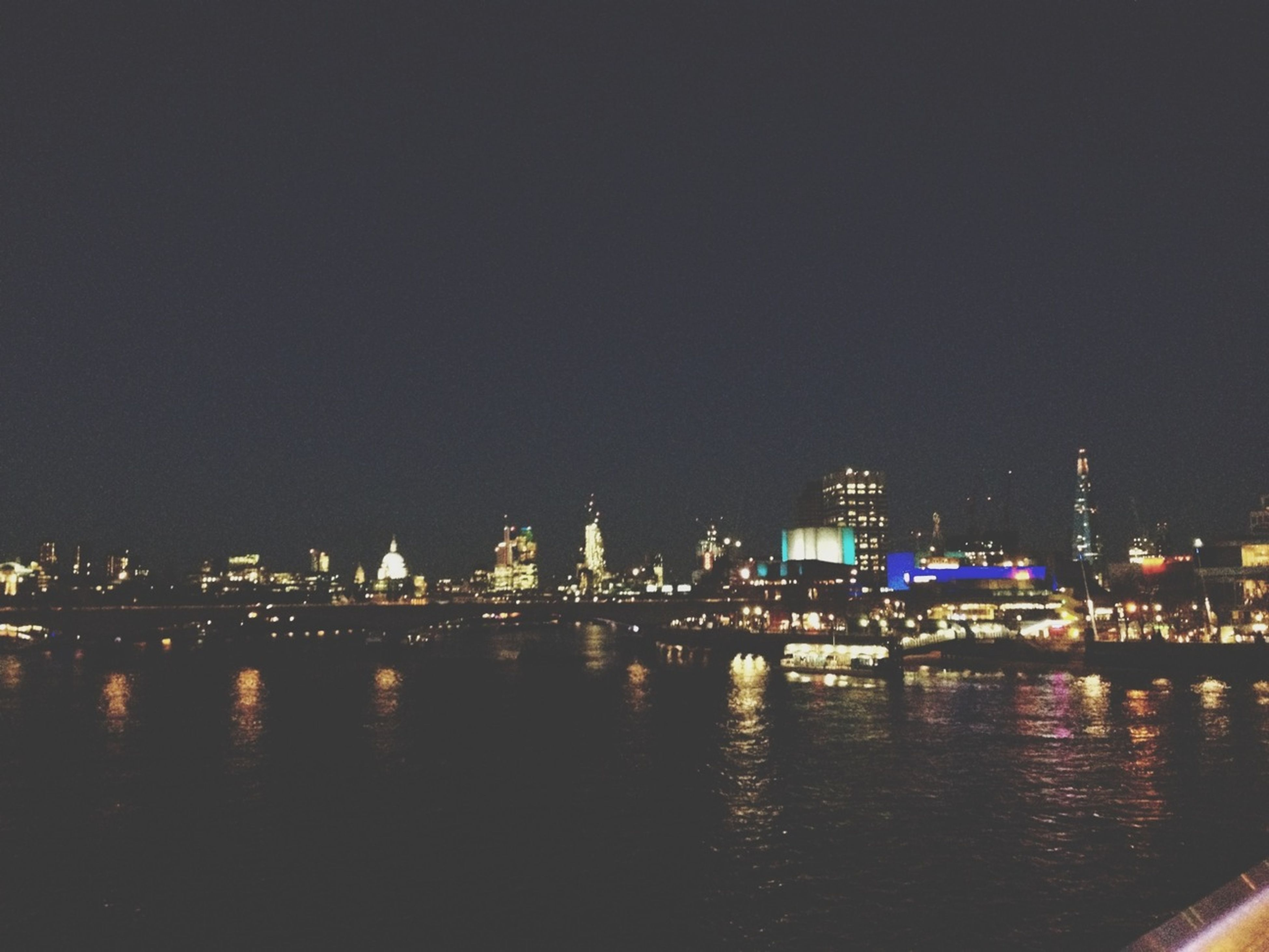night, illuminated, water, waterfront, building exterior, architecture, built structure, reflection, river, city, copy space, clear sky, lighting equipment, sky, outdoors, no people, sea, lake, dark, street light