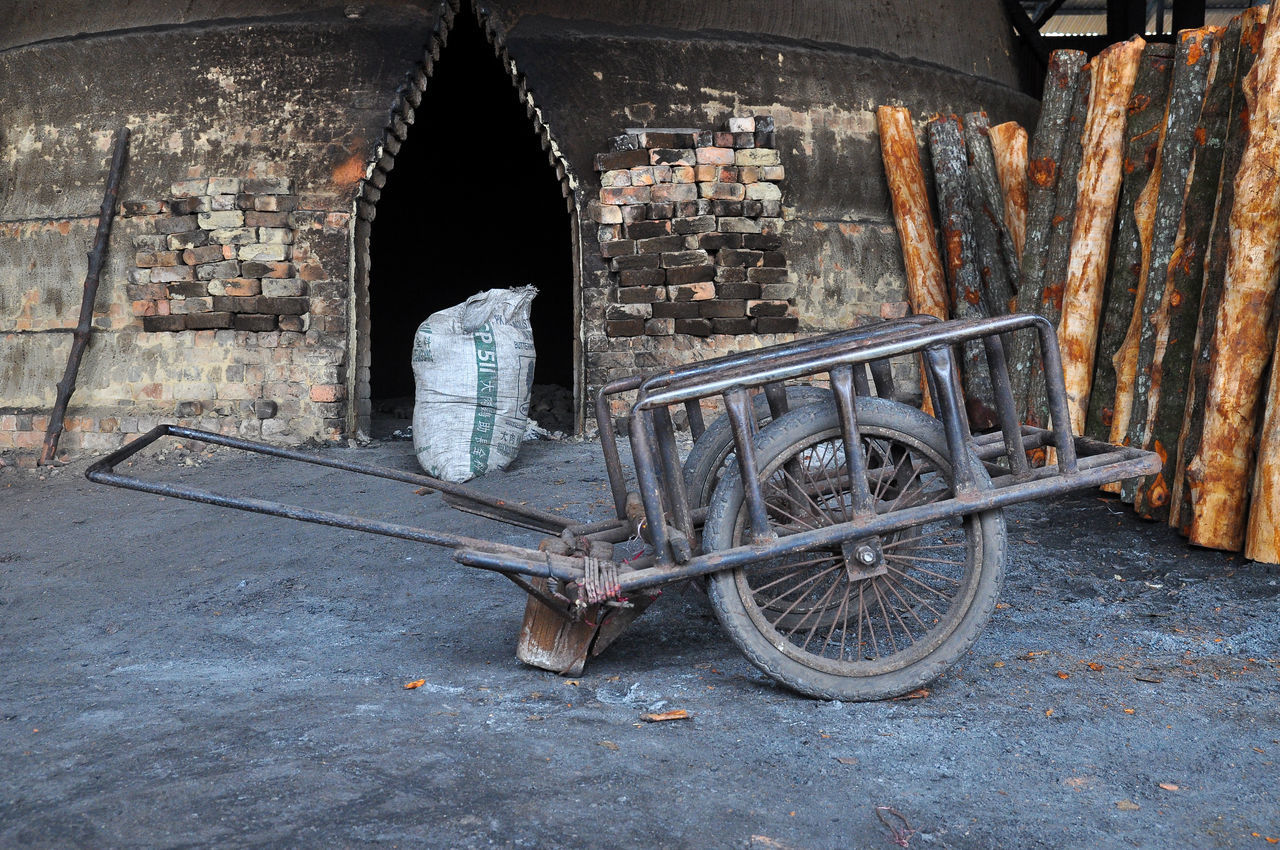 Pushchair in front of kiln Burninhell Charcoal Culture Factory History Indoors  Love Mangrove Mangroves No People Pushchair Tourist Attraction  Tourist Destination Tradition Travel Destinations