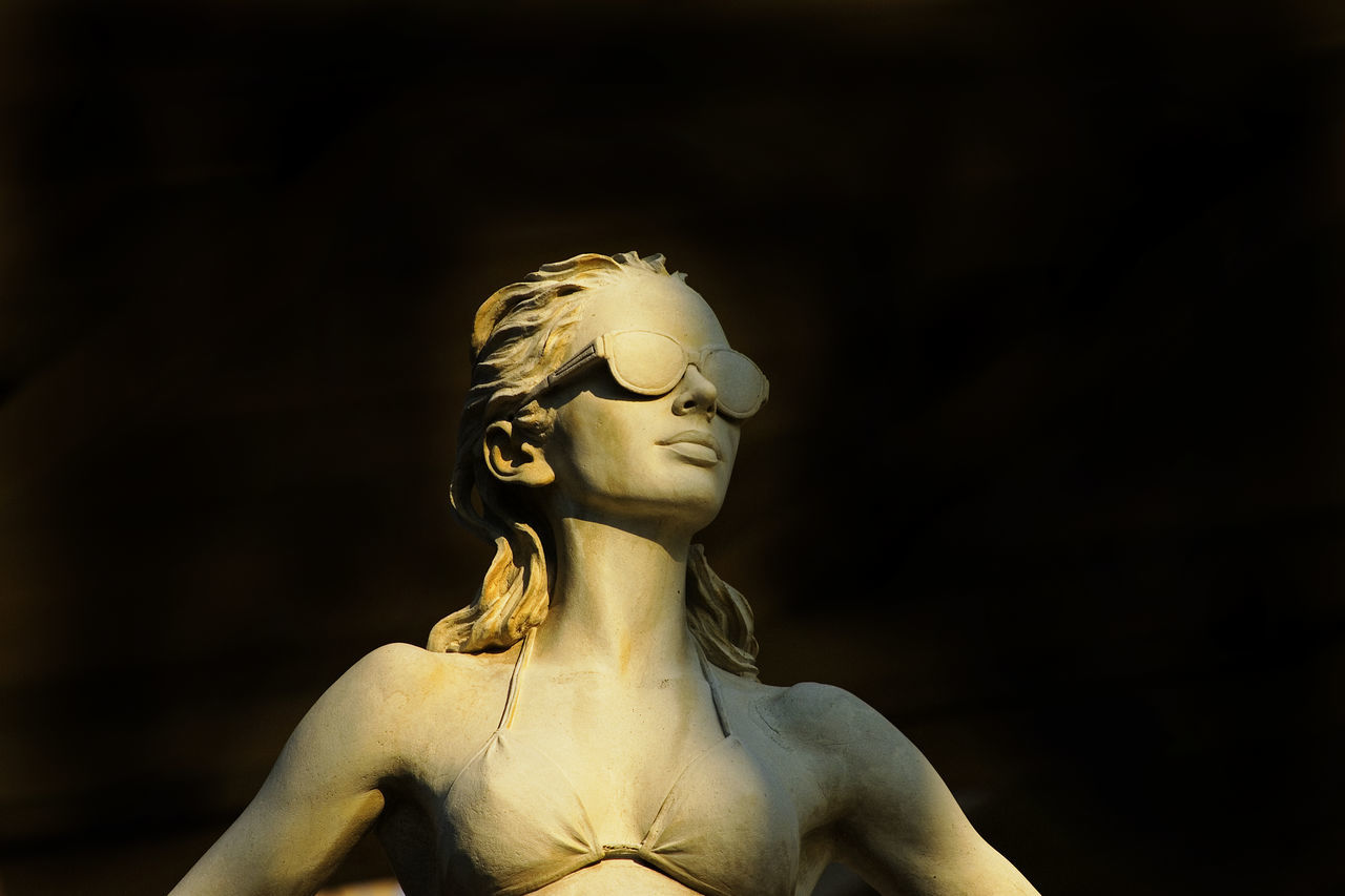 statue, human representation, sculpture, no people, focus on foreground, close-up, indoors, black background, day