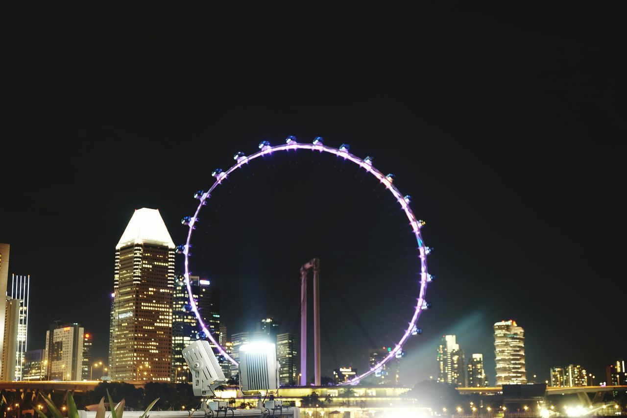 Ferris Wheel Night City Sky Illuminated Outdoors No People Motion Cityscape Urban Skyline Singapore Nightphotography Nightlife Night Life Night Sky Night View Nightshot Nightscape Futuristic Night Colors Playfullights Relaxing