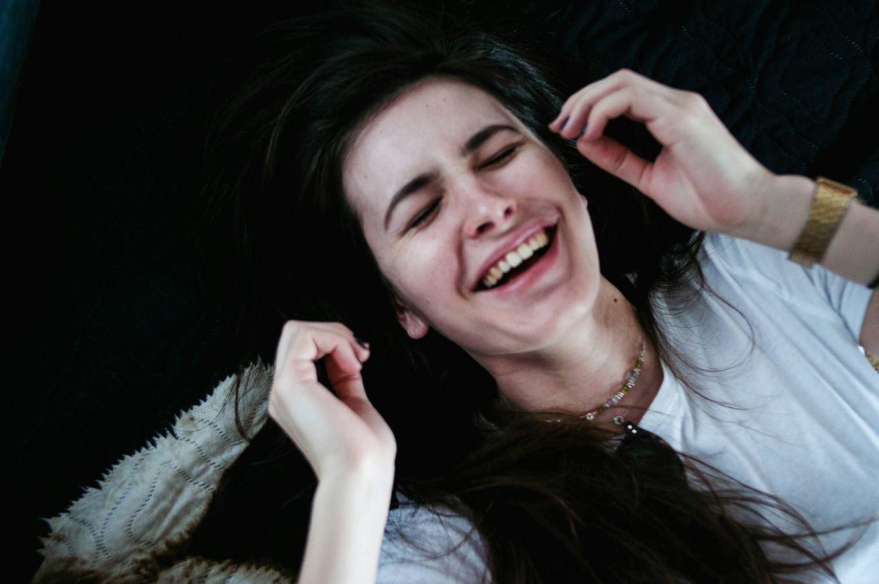 One Young Woman Only Eyes Closed  Happiness Beautiful Woman Beauty Leisure Activity Close-up Laughing Laughing Out Loud Laughter Long Hair Laying In Bed Layingdown Cozy At Home Black