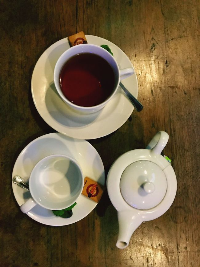 A cup of tea Cup Tea Cup Drink Table High Angle View Saucer Food And Drink Refreshment No People Tea - Hot Drink Teapot Indoors  Close-up Freshness Day