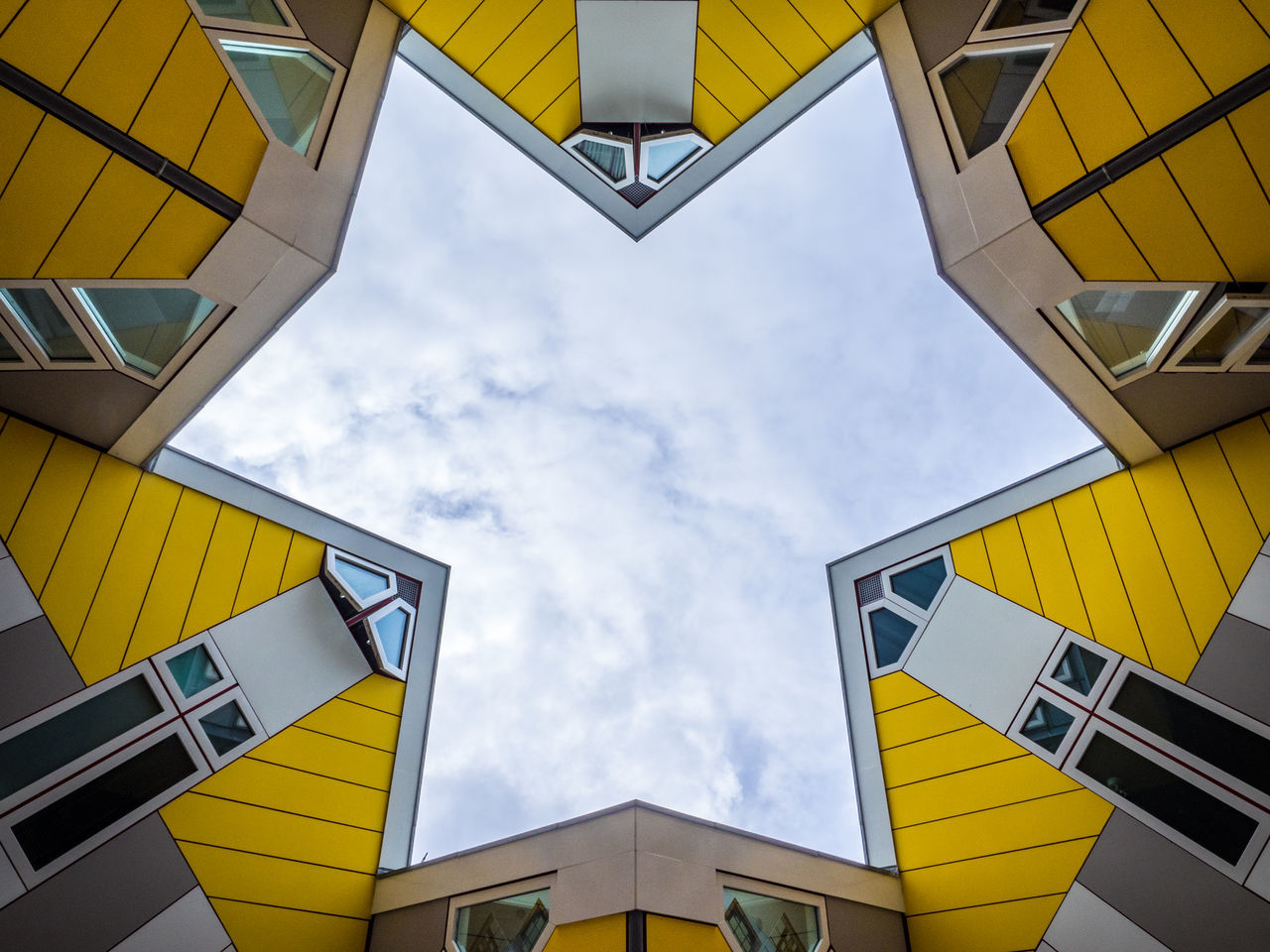 Rotterdam's famous cube houses, designed by Piet Blom. Architecture Art Building Exterior Built Structure Cloud - Sky Cube Houses Day Design Famous Place Holland Home Living Looking Up Low Angle View Modern Netherlands No People Outdoors Piet Blom Rotterdam Sky Star The Architect - 2017 EyeEm Awards Yellow