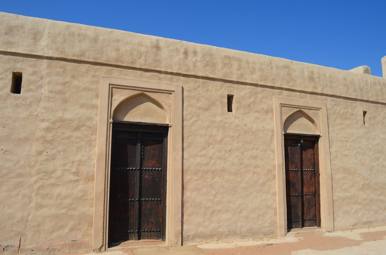 Arch Architecture Blue Sky Building Exterior Built Structure Day Door Doors Fort Fujairah Historical Building History Man Made Structure No People Outdoors UAE United Arab Emirates