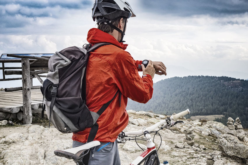 Portrait of mountainbiker with gps device Adventure Altitude Analyzing Bicycle Bikeguide Biker GPS Guide Man Monitor Mountainbike Mountainbiker MTB Navigation Outdoors Ride Self Tracking Smart Summit Südtirol Tour Tourguide Training Unfiltered Watch