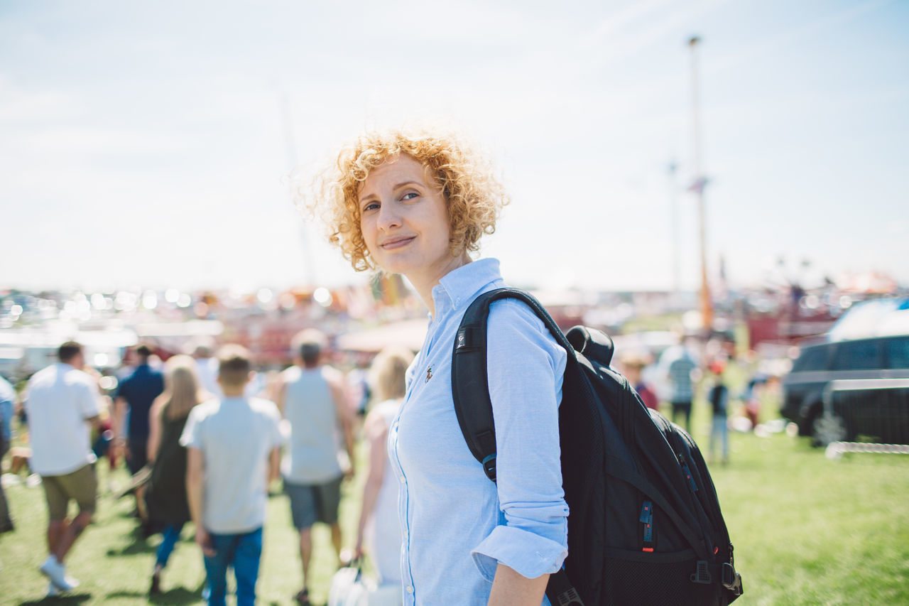 Adult Adults Only Beautiful Woman Blond Hair Casual Clothing City Curly Hair Day Epsom Downs Racecourse Focus On Foreground Incidental People Lifestyles Looking At Camera One Person One Young Woman Only Outdoors People Portrait Real People Sky Smiling Walking Women Young Adult Young Women