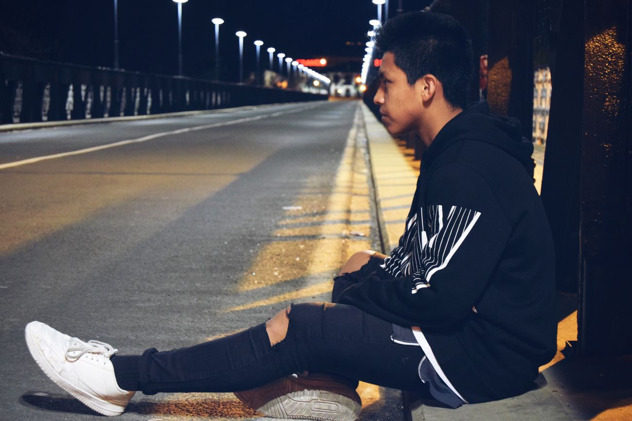 Young Men Men Street One Person Night Young Adult Lifestyles One Young Man Only Real People Sitting Outdoors City Leisure Activity Road Only Men Adults Only One Man Only Adult People First Eyeem Photo