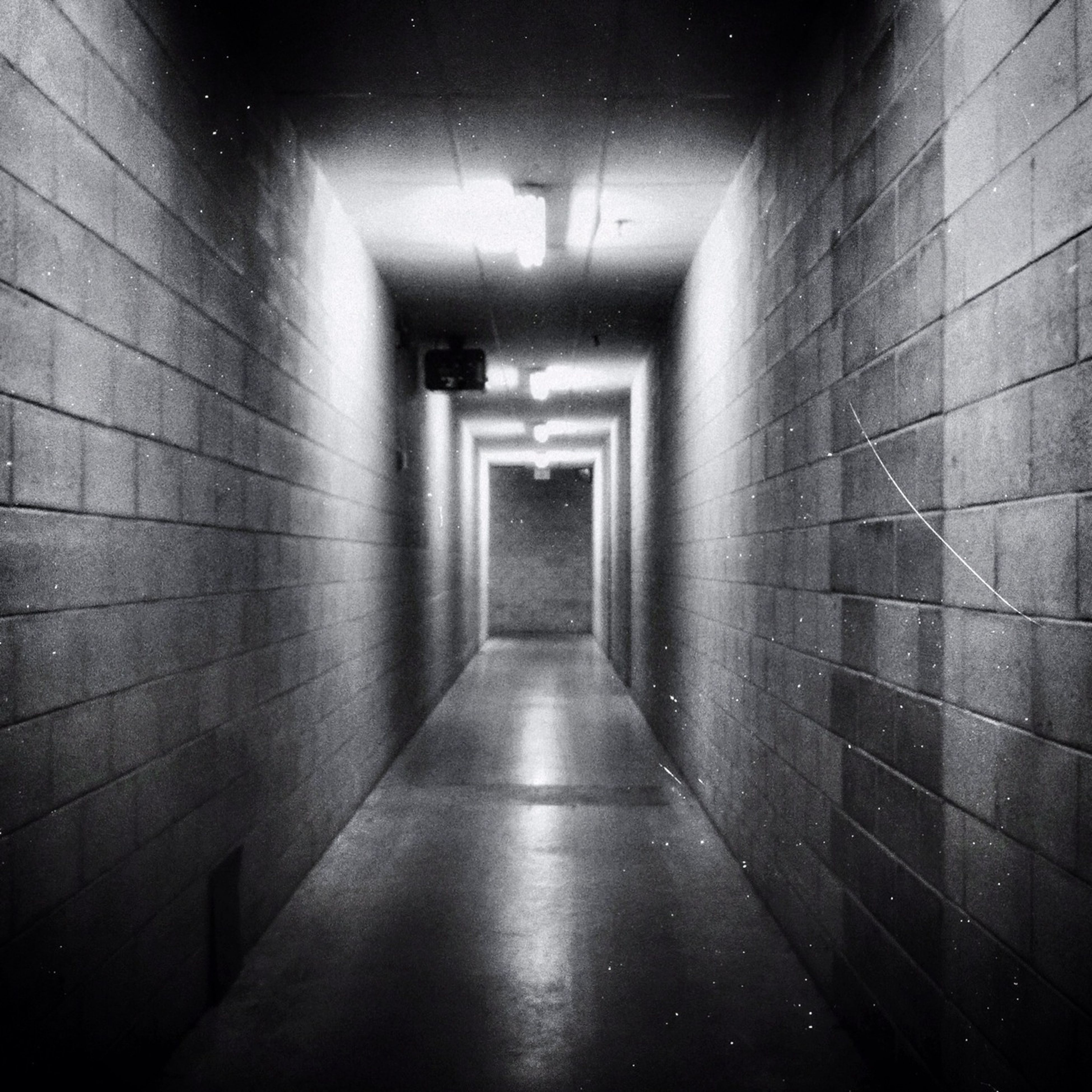 architecture, built structure, indoors, the way forward, corridor, wall - building feature, diminishing perspective, narrow, building, empty, illuminated, wall, building exterior, absence, lighting equipment, vanishing point, no people, walkway, long, tiled floor