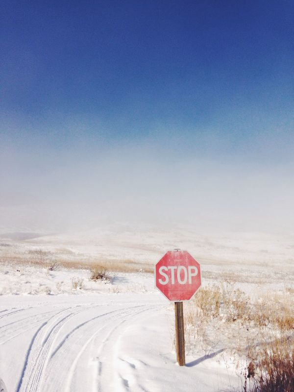 Beauty In Nature Cold Temperature Colorado Day Nature No People Nowhere Outdoors Road Sign Sand Sky Snow Text Tranquility Vertical Winter