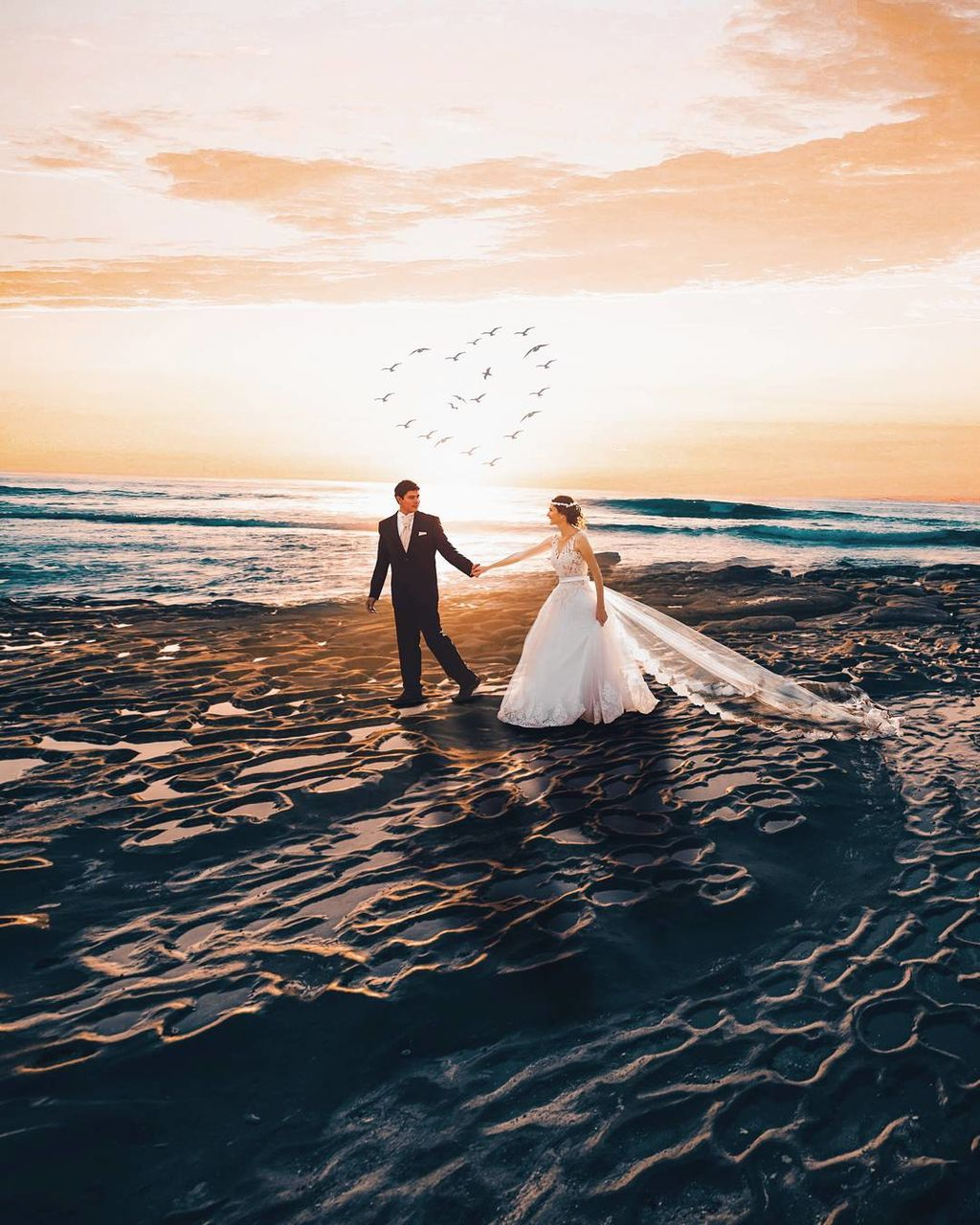 wedding, bride, wedding dress, sea, bridegroom, love, beach, sunset, celebration, nature, women, water, life events, scenics, groom, togetherness, real people, men, beauty in nature, full length, sand, young women, outdoors, married, horizon over water, sky, day, young adult, adult, people