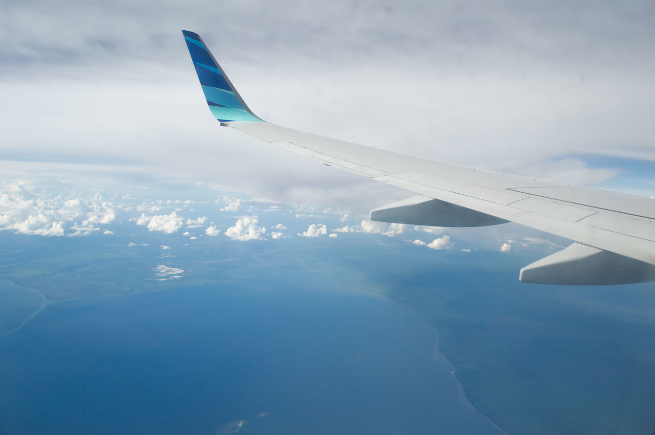 Garuda Indonesia. Garuda IndonesiaA Bird's Eye View Aerial View Aircraft Wing Airplane Airplane Wing Blue Cloud - Sky Flying Landscape Part Of Plane Sea Travel View From An Airplane Water Nature