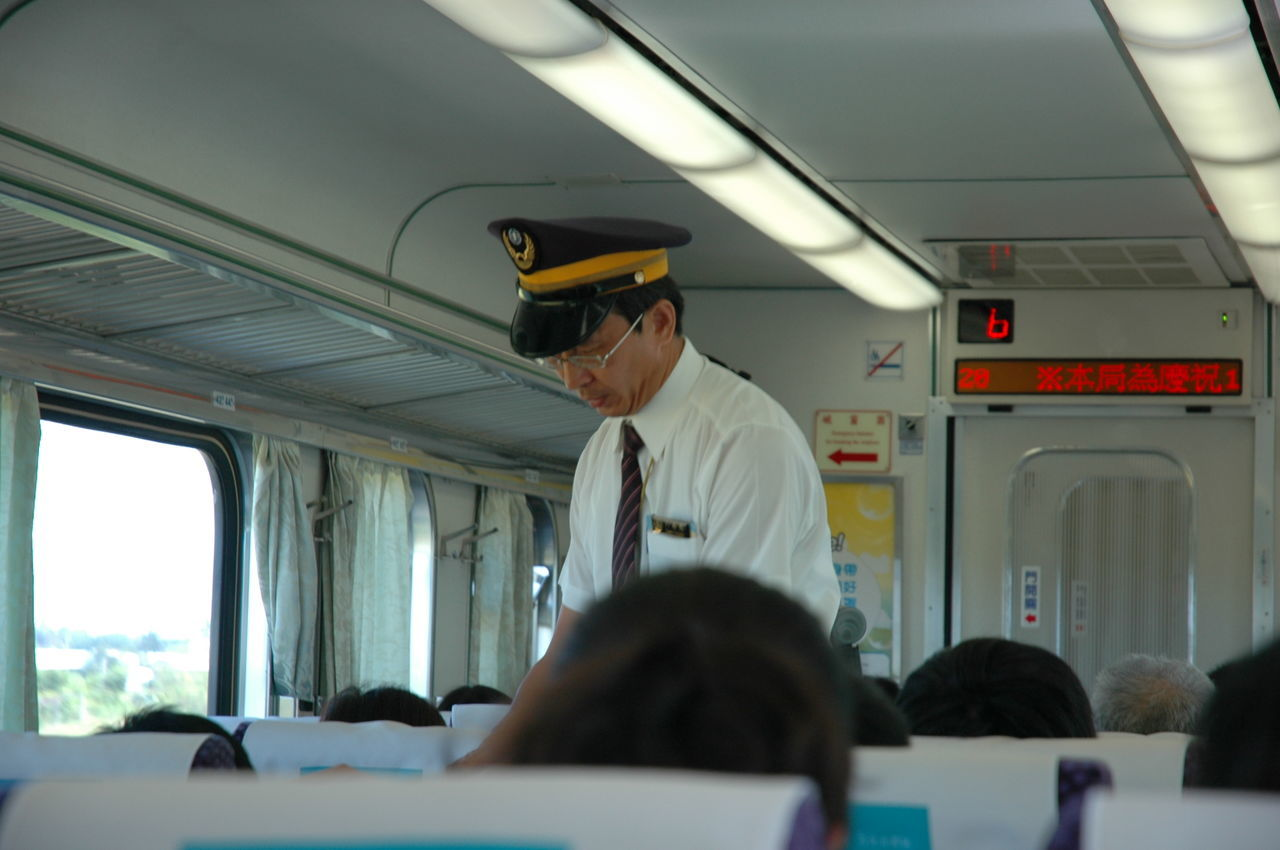 Traveling Home For The Holidays Transportation Occupation Indoors  Uniform Working People Train Ride Train Trains & Railroad Train Interior Public Transportation Train - Vehicle Rail Transportation Mode Of Transport Taiwan Passenger Journey Conductor Train Conductor