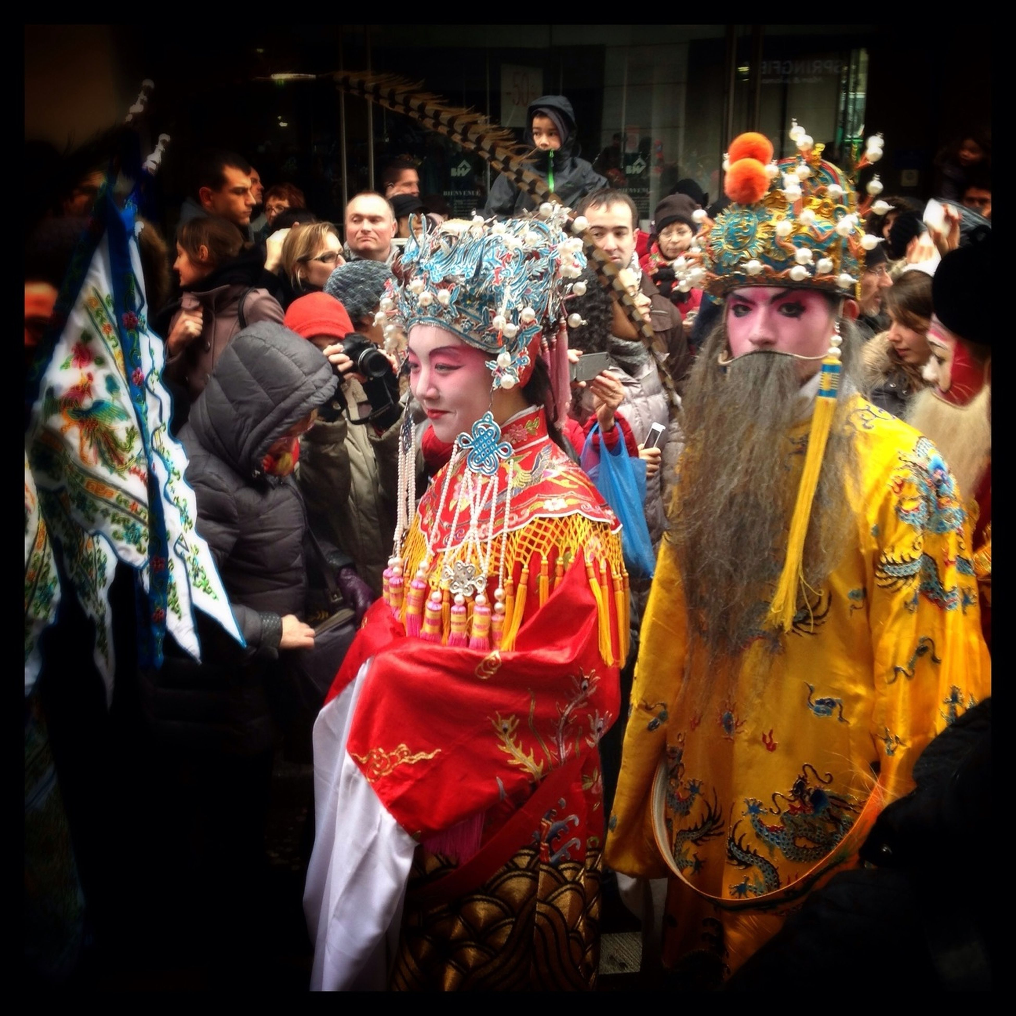 illuminated, indoors, night, celebration, men, cultures, arts culture and entertainment, tradition, person, large group of people, lifestyles, leisure activity, event, decoration, market stall, for sale, religion, retail, traditional clothing