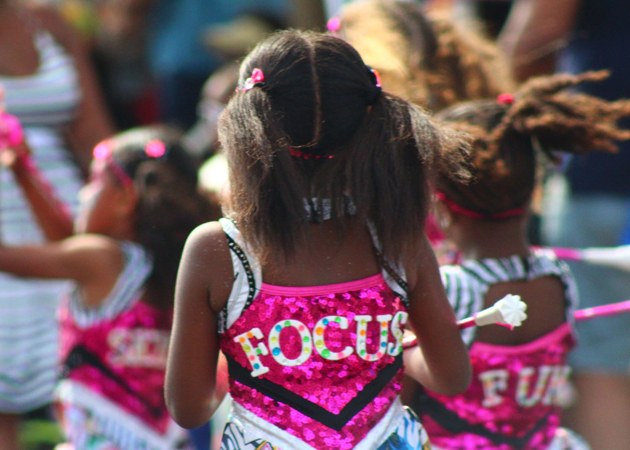 FOCUS Bermuda Bermuda Day Celebration Dancers Day Event Excitement Focus On Foreground Friendship Fun Girls Holi Leisure Activity Lifestyles Outdoors Parade People Real People Rear View Togetherness Traditional Festival