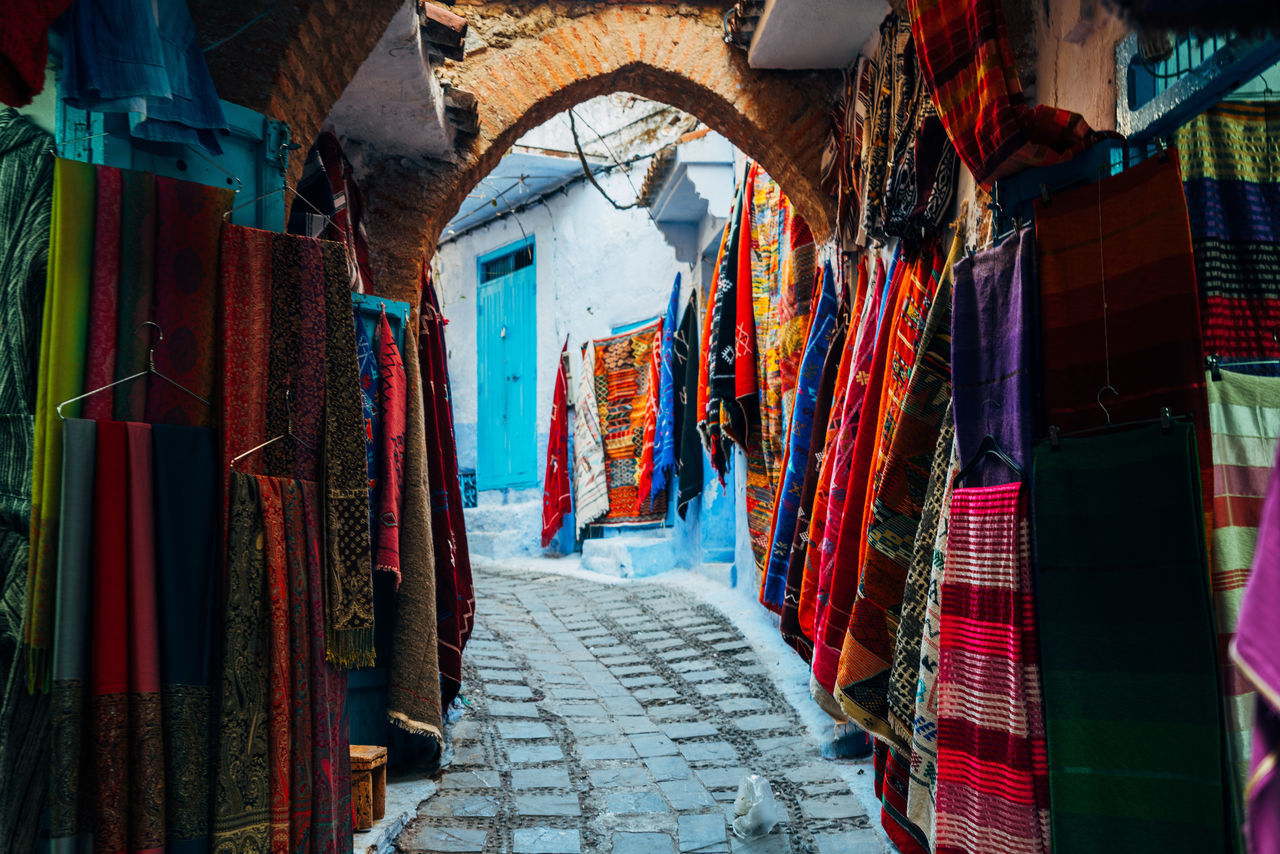 Multi Colored Clothes Hanging On Street For Sale