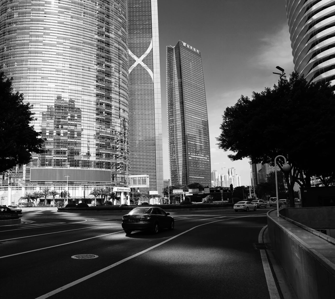 Zhujiang bouelvard City Building Exterior Car Built Structure Architecture Tree Street Road Transportation Land Vehicle Outdoors Skyscraper No People Day Guangzhou Zhujiang Town China Black And White