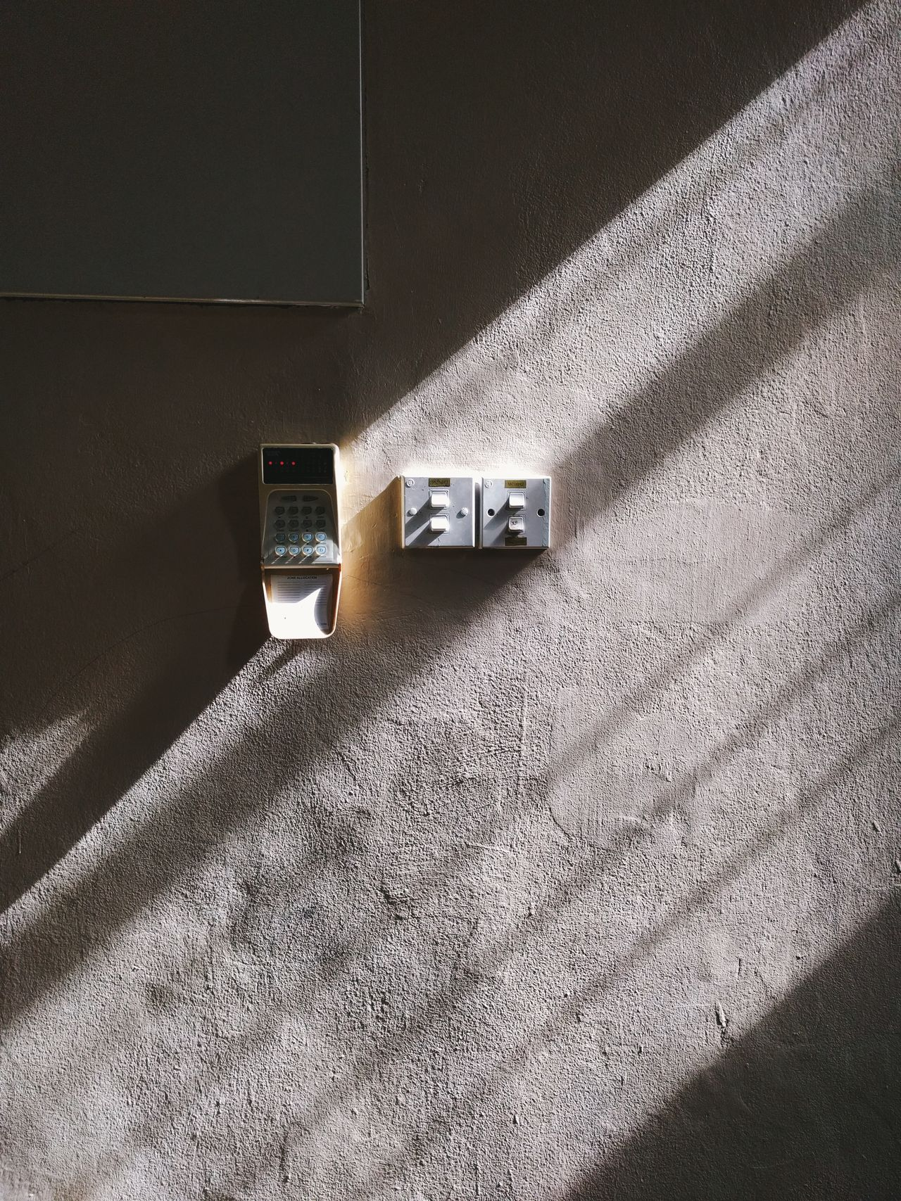 Beautiful lights are what makes the world goes round. No People Indoors  Day Textured  Built Structure Close-up Minmalism Minimalist Architecture Shadows & Lights Shadows On The Wall Electrical Switches