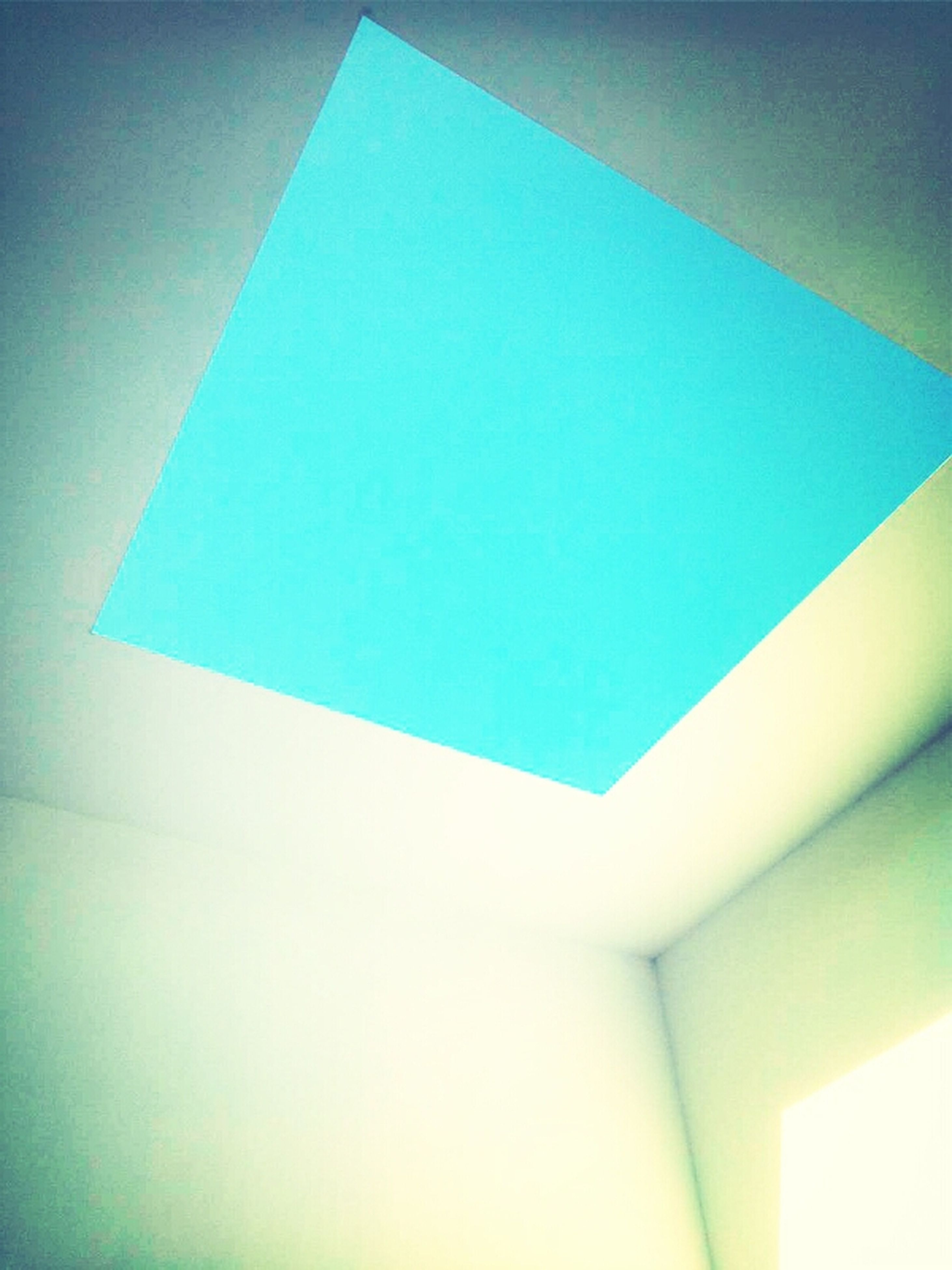 blue, indoors, low angle view, wall - building feature, architecture, built structure, close-up, geometric shape, pattern, copy space, multi colored, shape, wall, no people, backgrounds, abstract, white color, design, ceiling, full frame