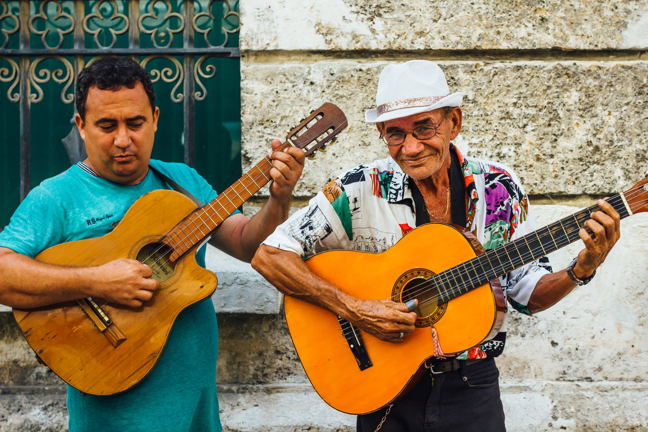 Cheerful Cuba Collection Cuban Cuban Life Guitar Guitarist Happiness Lifestyles Men Music Musical Instrument Musician Old Havana Outdoors Playing Plucking An Instrument Singer  Smiling Street Musician