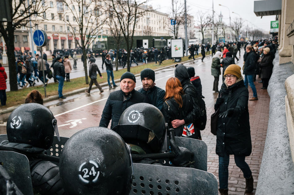 Minsk, Belarus - March 25, 2017 - Special police unit with shields against ordinary citizens and protesters. Belarusian people participate in the protest against the decree 3 Lukashenko and the current authorities. Active Activism Belarus Belarus Nature Citizen Demonstration People Police Police Force Protest Protesters Protesting Rally Reportage Riot Street
