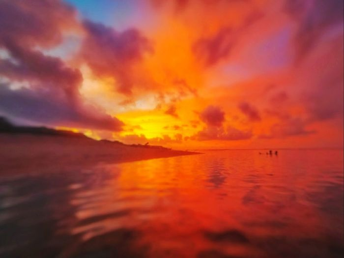 Sunset in Ilocos Norte Philippines Sunset Sea Scenics Water Beauty In Nature Nature Tranquil Scene Reflection Tranquility Dramatic Sky Sky Outdoors Cloud - Sky No People Horizon Over Water Beach Day