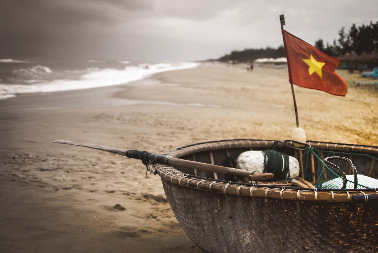 Hoi An Beach CAM PHOTOGRAPHY Coracle Phuong Cam An Phuong Cam Chau Phuong Cam Pho Quang Nam Province Quang Nam, Vietnam Round Boats Sand Sea Thung Chai Tinh Quang Nam Vietnam Vietnamese Flag