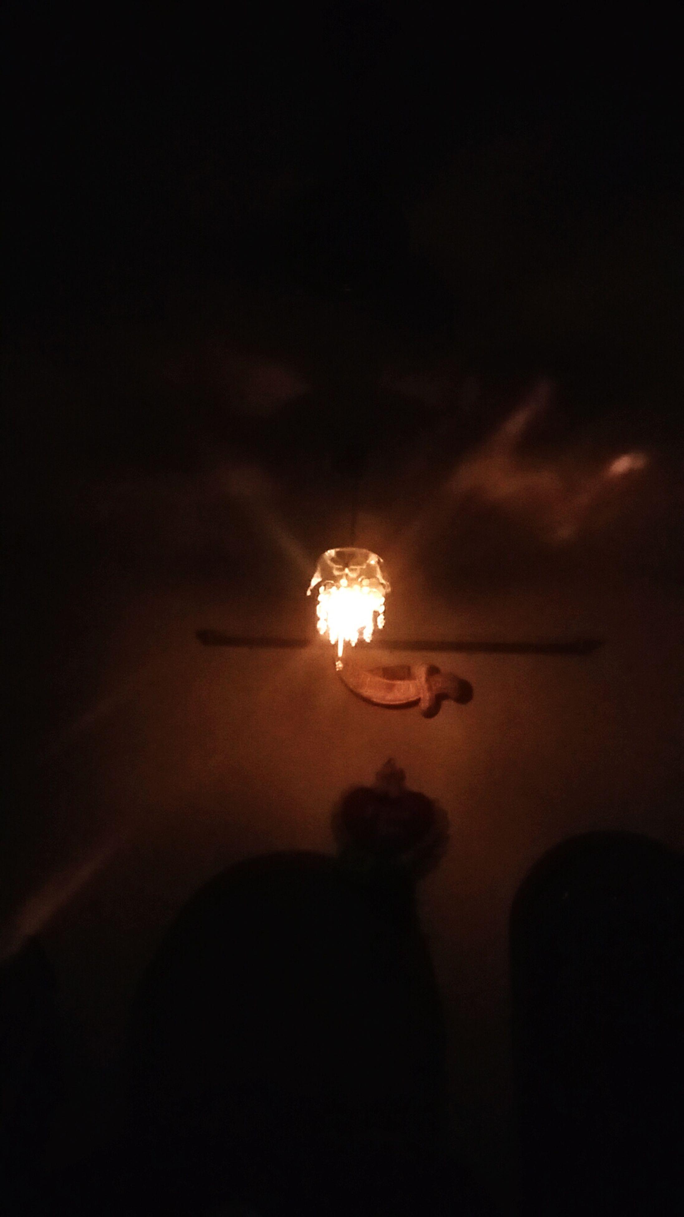 illuminated, lighting equipment, night, electricity, low angle view, glowing, dark, electric light, light - natural phenomenon, street light, copy space, lit, electric lamp, indoors, light bulb, sky, light, hanging, lamp, lantern