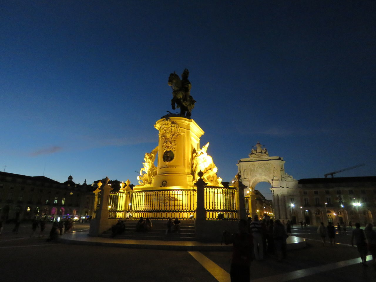 statue, sculpture, human representation, art and craft, male likeness, architecture, built structure, history, building exterior, monument, night, gold colored, outdoors, travel destinations, illuminated, city, arts culture and entertainment, sky, low angle view, clear sky, baroque style, king - royal person, no people