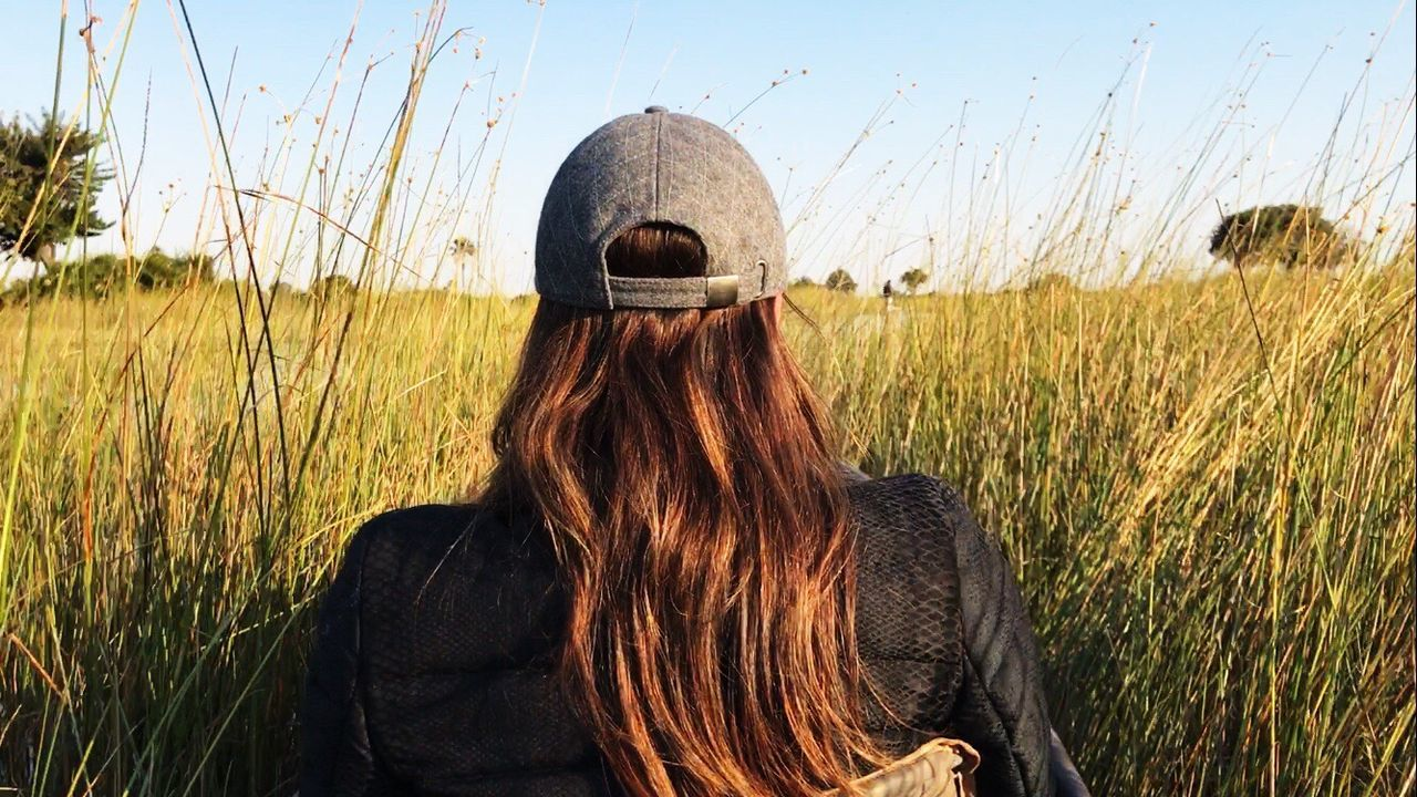 Betty in a Mokoro Canoe Reeds In Water Reeds Long Hair One Person Only Women Rear View Grass Outdoors Nature Sky Okavango Delta