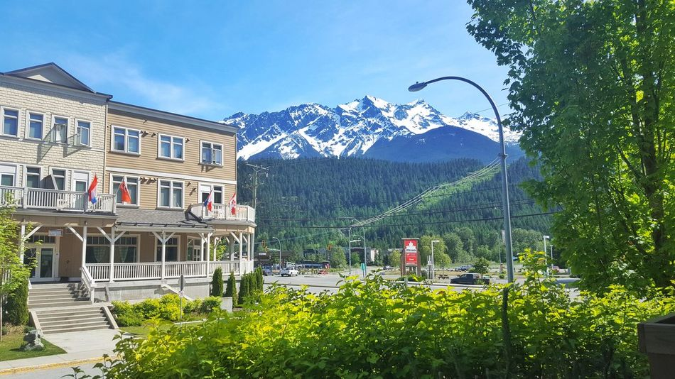 Mountain Blue Sky Clear Sky Outdoors No People British Columbia, Canada Pemberton Clear Sky Historic Building Architecture Canada Heritage Building Snowcapped Mountain Mountain Peaks Tranquil Relaxing Sunshine Summer Adapted To The City Flags Leaves Green