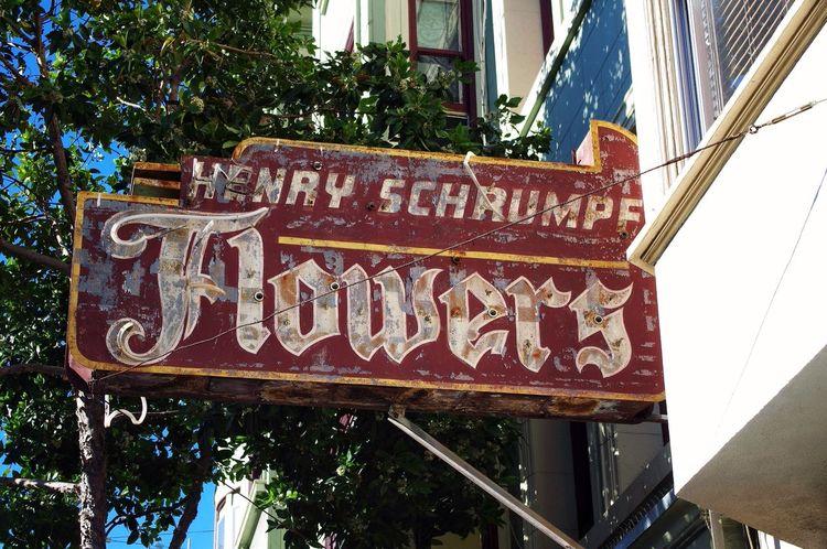 Henry Schrumpf Flowers Street Sign