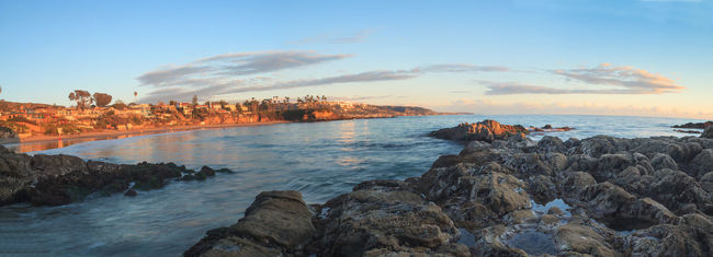 Crescent Bay beach panoramic view of the ocean at sunset in Laguna Beach, California, United States in summer Beach California Clouds And Sky Crescent Bay Day Laguna Beach No People Ocean Outdoors Panorama Panoramic Panoramic Landscape Panoramic Photography Rock - Object Sea Sky Sunset Sunsets Water